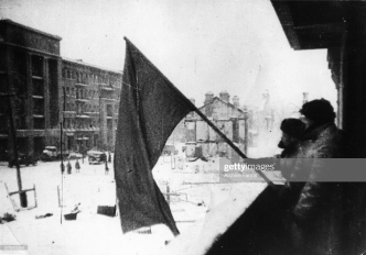 The red banner of the Soviet Army is hoisted up in a recaptured part of Stalingrad, as the German Sixth Army is beaten, 1943. (Photo by Archive Farms/Getty Images)